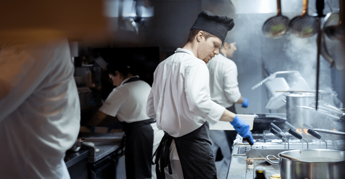 Chef cooking in industrial kitchen