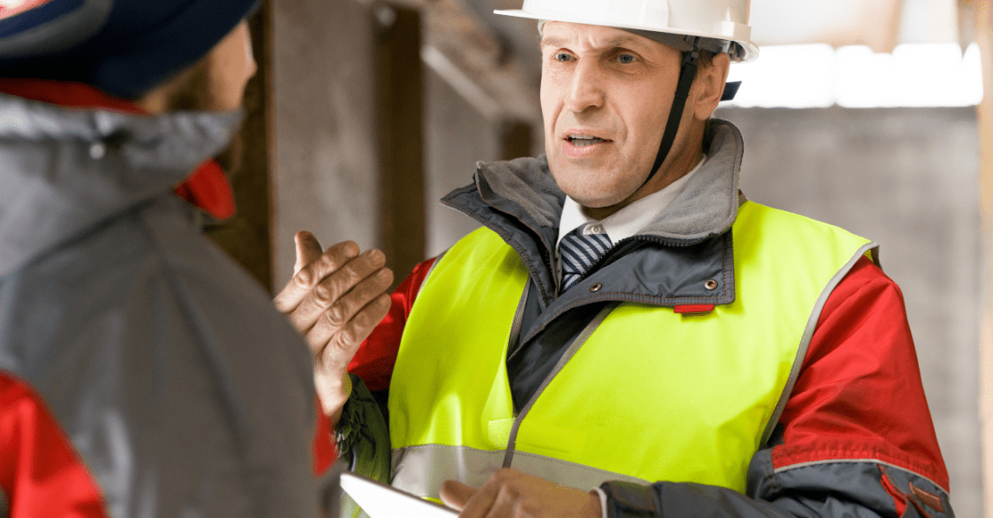 OSHA Inspector talking to a business manager