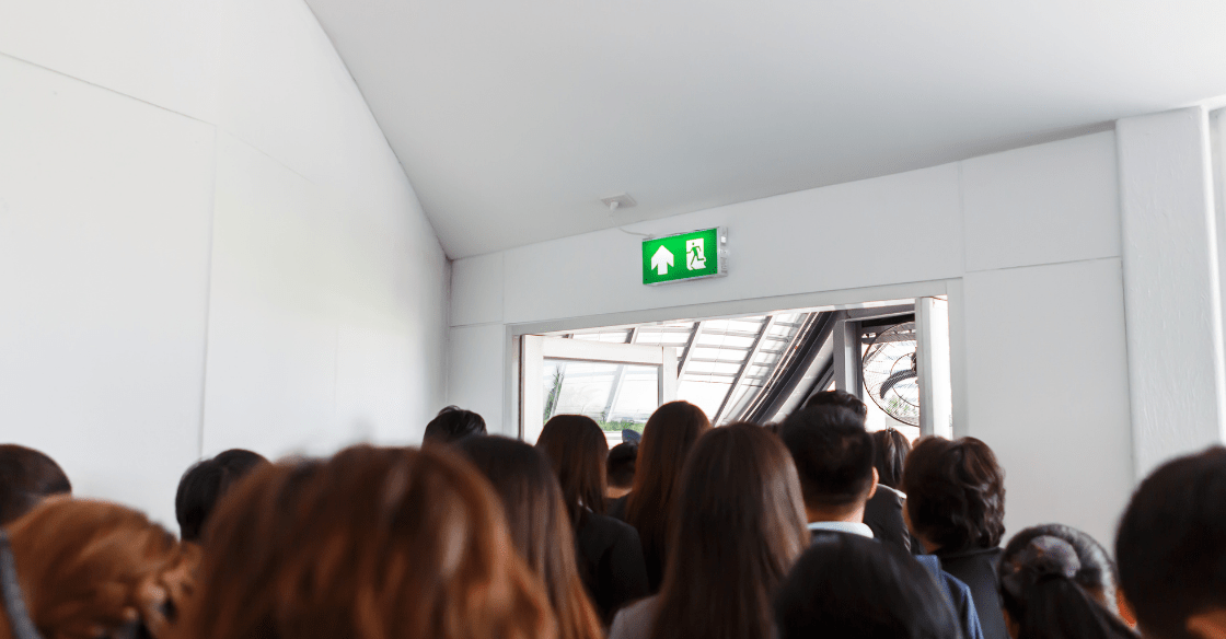 People following exit signs during an emergency